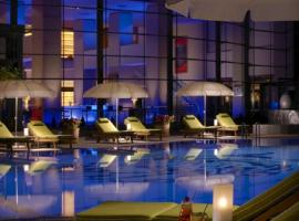 Pool area in luxury hotel at night