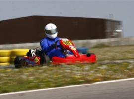 Racer in the curves of go kart track